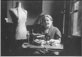madame marie with sewing machine 1